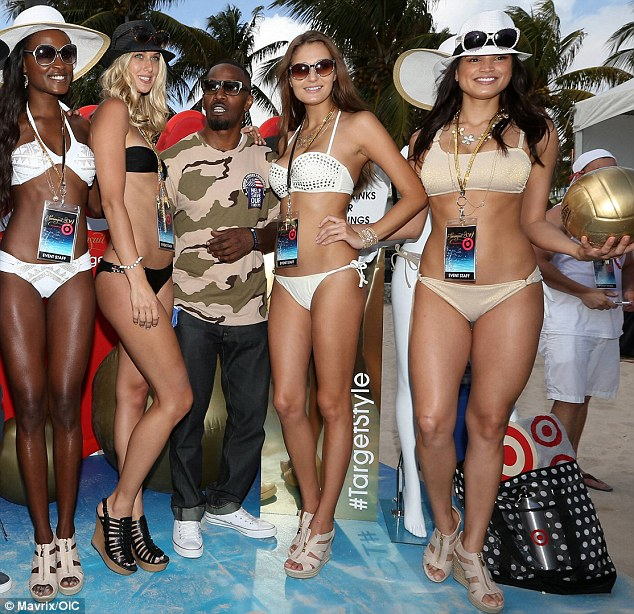 How does he do it? Jamie Foxx, 46, found himself center of attention at the Sports Illustrated Swimsuit Beach Volleyball Tournament after party held on Ocean Drive in Miami Beach on Thursday