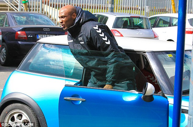 Bit of a tight spot: Lamar Odom squeezes himself out of a Mini in Vitoria, Northern Spain on Thursday