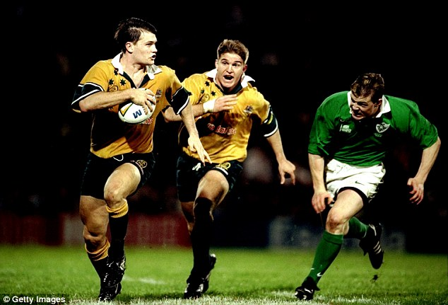 Burned: O'Driscoll during one of the less impressive moments of his debut in 1999 chasing Ben Tune