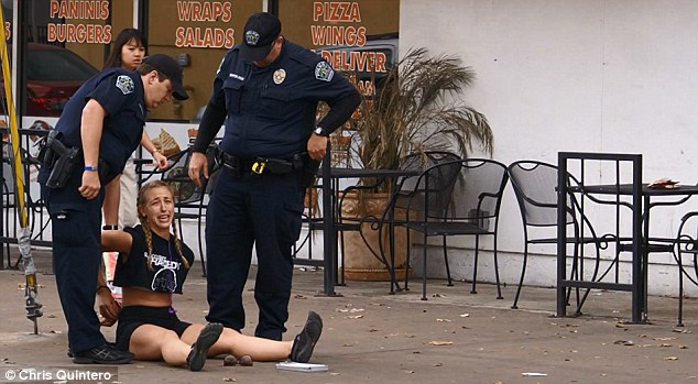 Busted: Amanda Jo Stephen, 24, is seen handcuffed and in tears following Thursday's arrest for a traffic violation in Austin