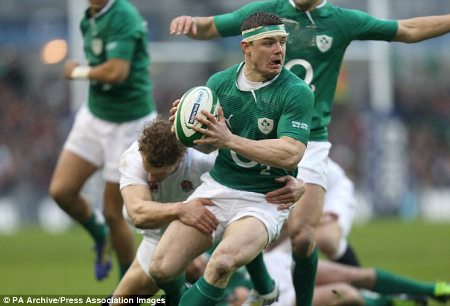 Last time: Brian O'Driscoll is tackled by England's Billy Twelvetrees when the side's met in 2013