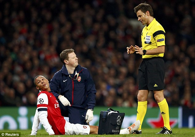 Down and out: Kieran Gibbs limped off in Arsenal's defeat by Bayern Munich midweek