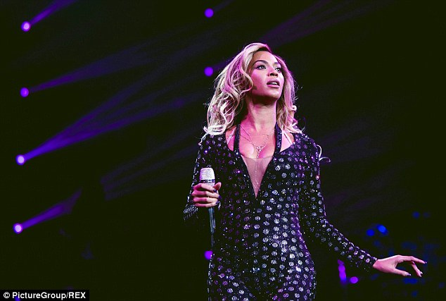 Wow: As well as her tartan attire, the superstar singer sported an array of outfits including a stunning black bodysuit with silver embellishment