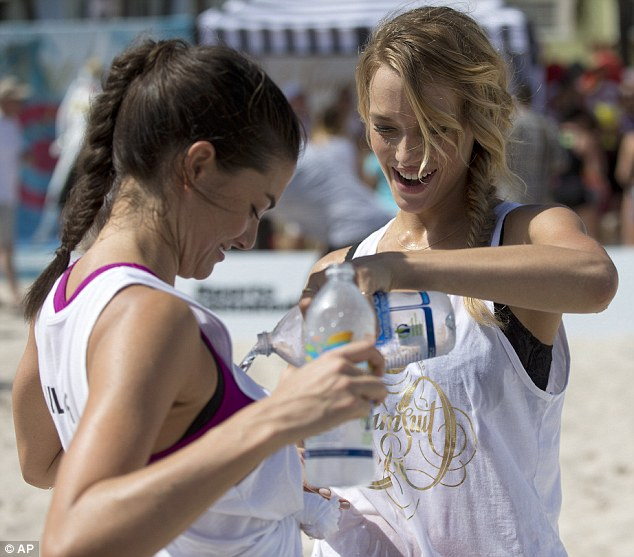 Their own wet T-shirt competition: Hannah Ferguson, right, poured water over Lauren Mellor after the two finished a volleyball game