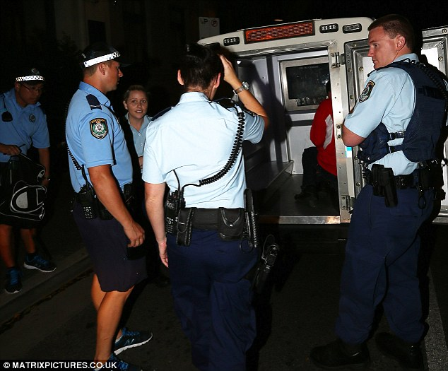 Arrested: The man was taken away in a police van