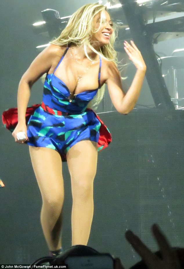 Taking the plunge: Beyonce was lucky not to fall out of her top as she took to the stage in Glasgow in a playsuit which could barely contain her assets