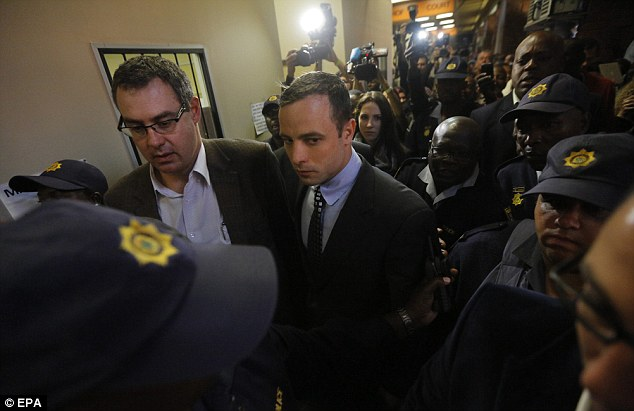 On trial: Pistorius walks through the Pretoria Magistrates Court in June 2013. His trial begins next month