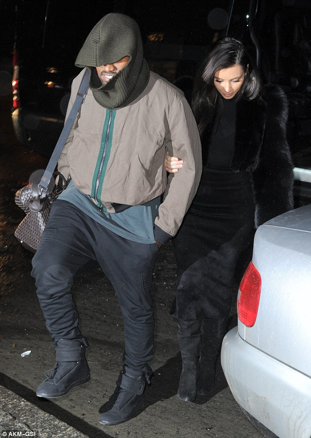 Hold on: Kanye lent his bride-to-be his arm to ensure she did not slip in her six inch heels