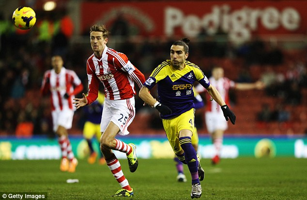 On a run: Stoke striker Peter Crouch (left) is looking to score for the third game in a row