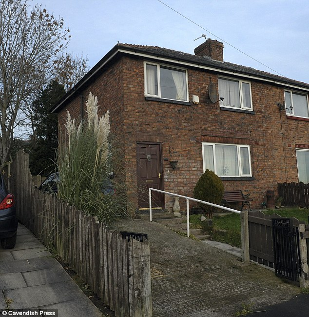 Grim: The council house in Tyldesley, Greater Manchester, where the dogs were kept by Higgins and Warren