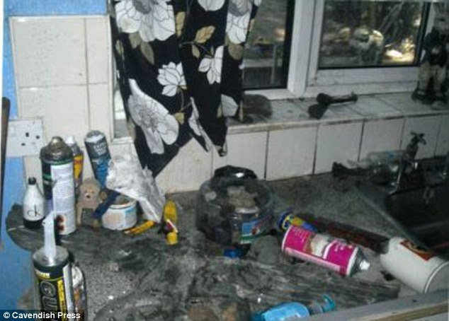 Squalid: The dirty property in Tyldesley, near Wigan, Greater Manchester, which was caked in urine and faeces