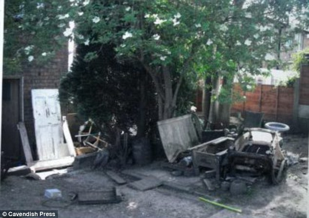 Dirty: The outside of the three-bedroom council house which was caked with dirt