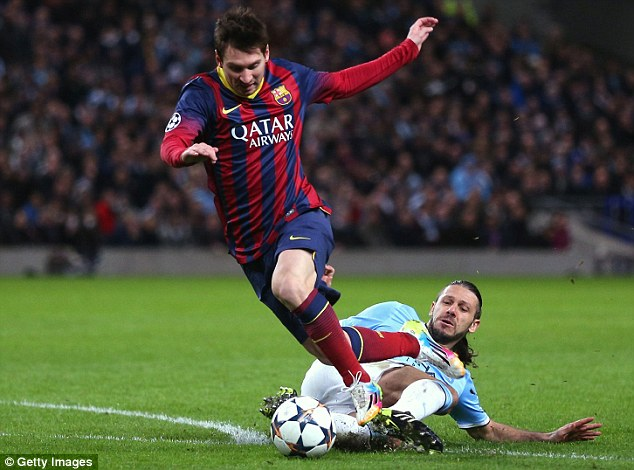 Felled: Martin Demichelis was sent off on Tuesday as Manchester City went down 2-0 against Barcelona