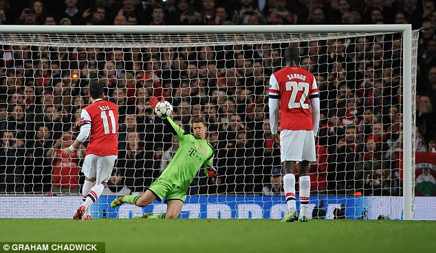 Dink! Mesut Ozil missed a penalty early on for Arsenal during Wednesday's game against Bayern Munich