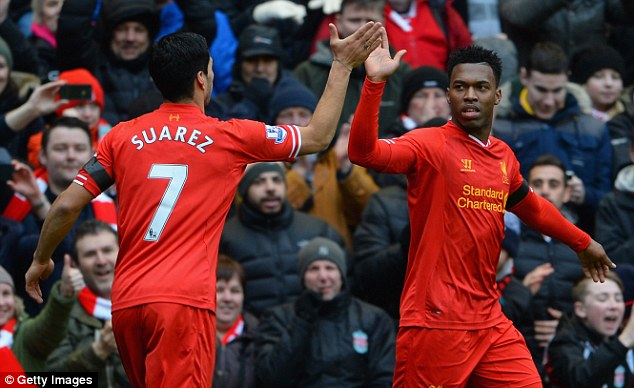 Combo: Suarez and Daniel Sturridge have combined to lethal effect this season