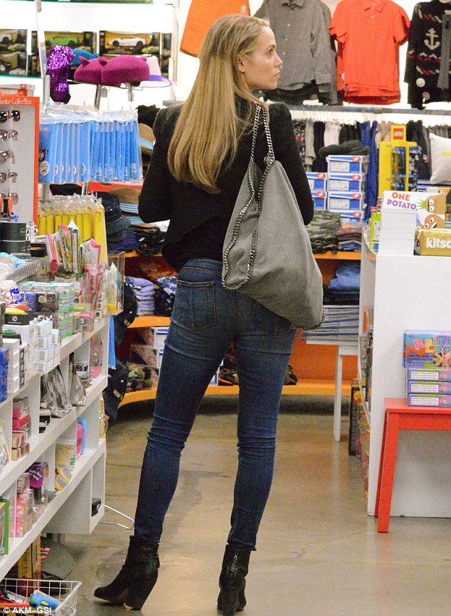 Hair-raising times: Elizabeth Berkley has hardly had anytime for her since giving birth to her son Sky Cole seven months ago and it showed when she shopped  at Kitson in West Hollywood