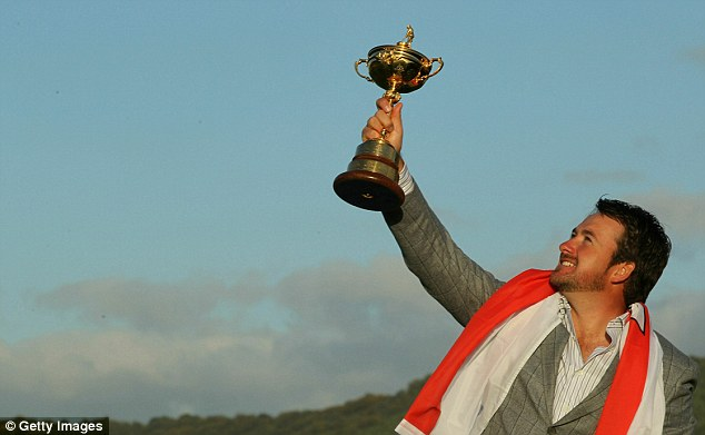 Reach for the sky: The Ulsterman lifts the Ryder Cup aloft in South Wales four years ago