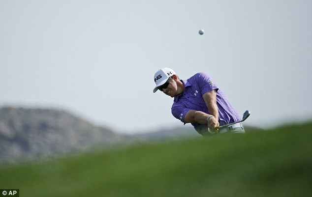 Hunting G-Mac: Mahan hits from the fairway on the first hole at Dove Moutain on Friday