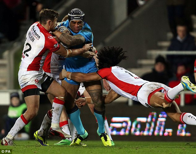 Crunch: St Helens duo Jon Wilkin and Sia Soliola make a tackle