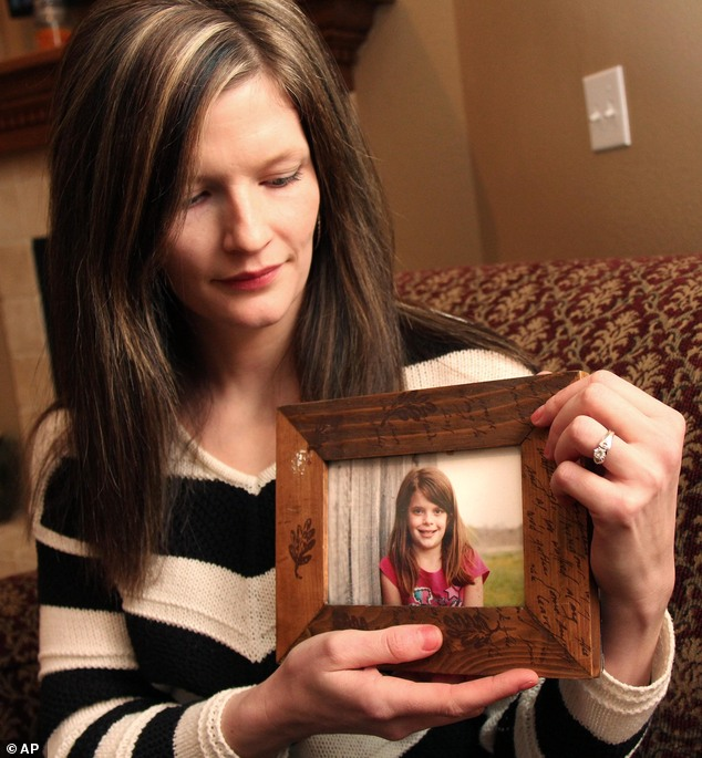 Shocking: Erin Petersen holds a photo of her niece, Hailey Owens, following the girl's kidnapping and murder