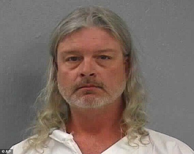Accused killer: Craig Michael Wood, pictured, was charged on February 19, 2014, with first-degree murder in the death of 10-year-old Hailey
