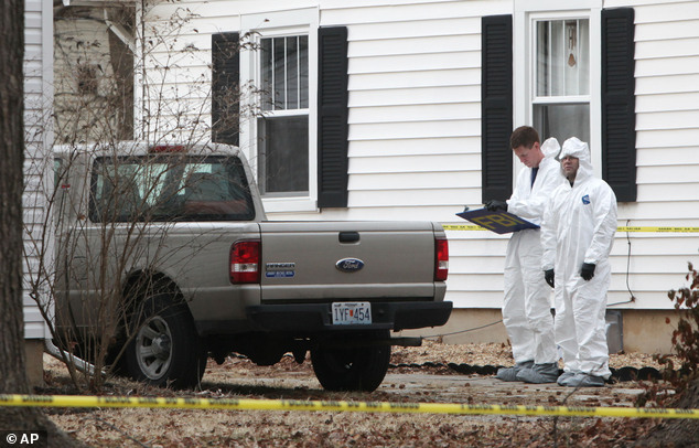 Body: Police and FBI agents were at Wood's house investigating after finding Hailey's body in the basement
