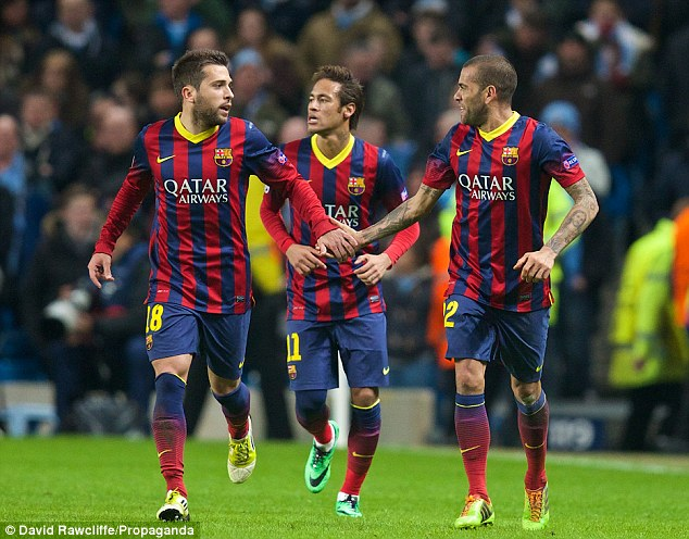 Late strike: Alves celebrates with Jordi Alba (left) and Neymar