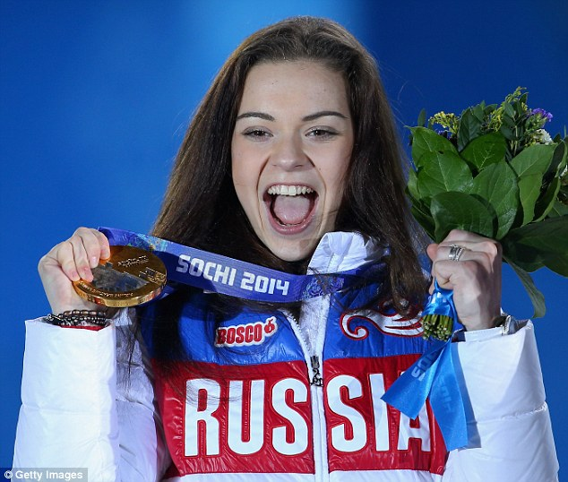 Triumph: Gold medalist Adelina Sotnikova of Russia celebrates during the medal ceremony for the Women's Free Figure Skating on day fourteen of the Sochi 2014 Winter Olympics