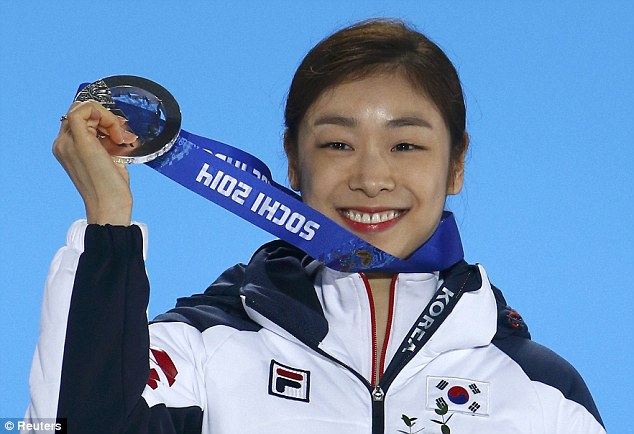 Second place: Silver medalist South Korea's Yuna Kim smiles during the victory ceremony for the figure skating women's free skating program