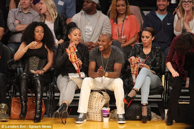 Having fun: Mayweather was pictured with three women - he is rumoured to have split from Shantel Jackson