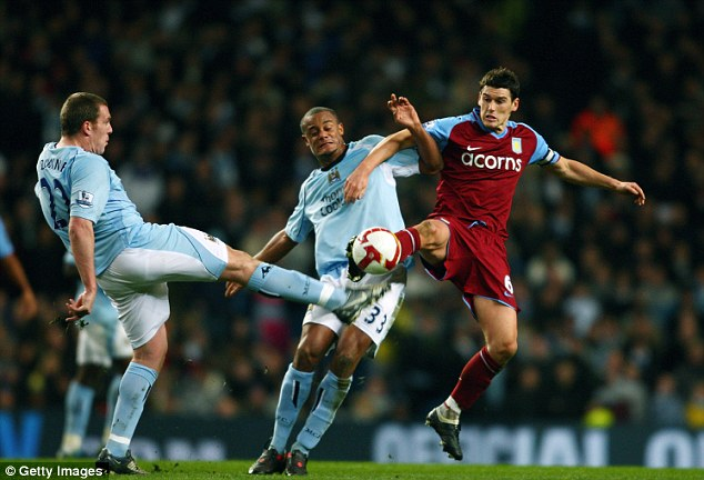 Great signing: Hughes brought in Kompany to the club, who has been a mainstay in the defence since