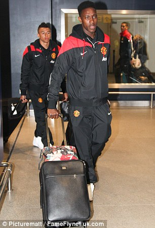 Back on home soil: Welbeck (left) and Young (right) returned from the club's training trip to Dubai on Monday