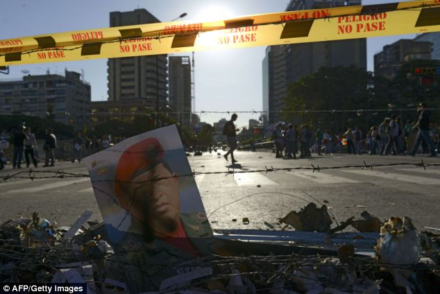 View of a poster of late Venezuelan President Hugo Chavez in a barricade