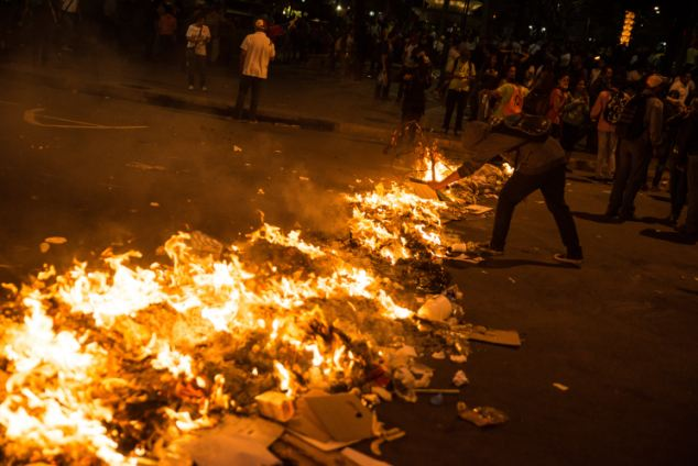 A barricade is set alight as students continued to stage anti-government protests on the streets of Caracas