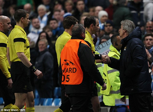 Losing his cool: Pellegrini remonstrates with the referee at the final whistle