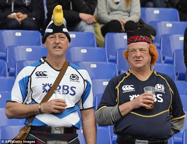 Finally something to smile about: Scotland fans saw their side win for the first in the 2014 Six Nations