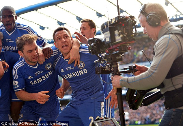 Blues brothers: John Terry (C) celebrates after a late goal gave Chelsea  1-0 win against Everton