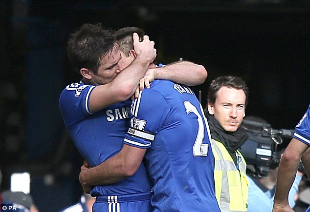 Man love: Frank Lampard hugs Terry after his free-kick was converted for the winner