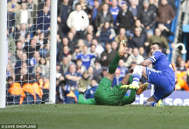 Butterfingers? The ball travels over the line after being mishandled by Everton keeper Tim Howard (L)