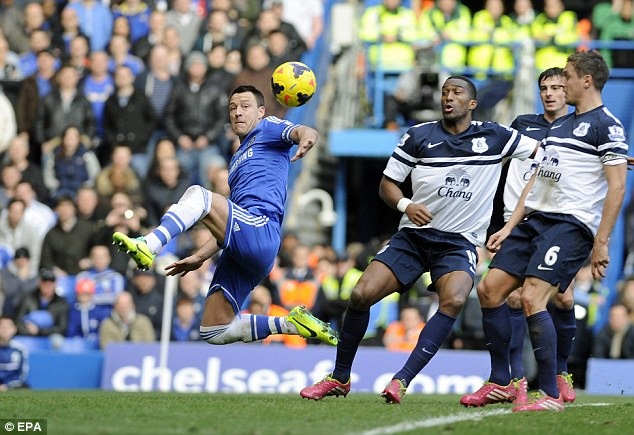 Lunge: Terry claims he got a touch to the ball for Chelsea's injury time goal