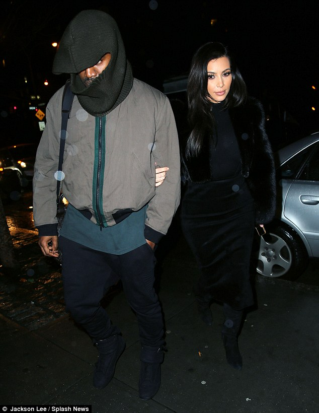 Fashion fail! Kanye drew attention to himself when he stepped out with Kim on Thursday wearing a bizarre green balaclava hat