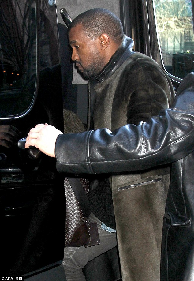 Travelling in style: West, who is the fiancé of reality TV star Kim Kardashian, was ushered into a large black vehicle