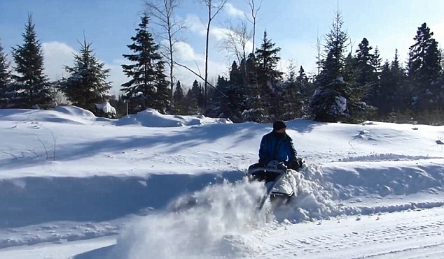 The machine can plow through high mounds of snow
