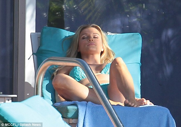 You must need a rest! Joanna closed her eyes and relaxed after yet another day of poolside fun
