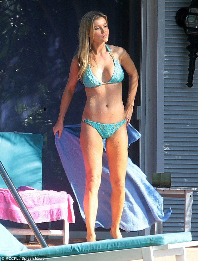 Bathing beauty: Joanna Krupa, 34, enjoyed a day beside the pool in Miami, Florida on Saturday