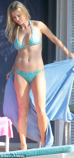 Tanned and toned: The Real Housewives Of Miami star wore a turquoise lace bikini as she made the most of the good weather