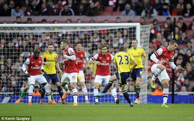 Consolation: Emmanuel Giaccherini cracks home Sunderland's goal late on