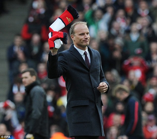 Immortalised: Former Arsenal striker Dennis Bergkamp received a rapturous reception when introduced to the crowd at half-time
