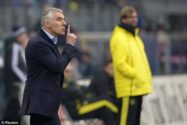 Silencing the critics: New manager Mirko Slomka made the perfect start to his Hamburg career as Dortmund were brushed aside
