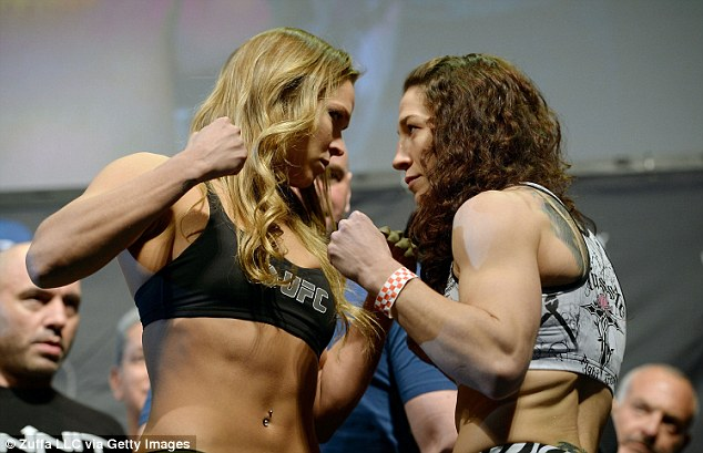 Getting ready: Rousey and McMann look fierce during their weigh-in on Friday